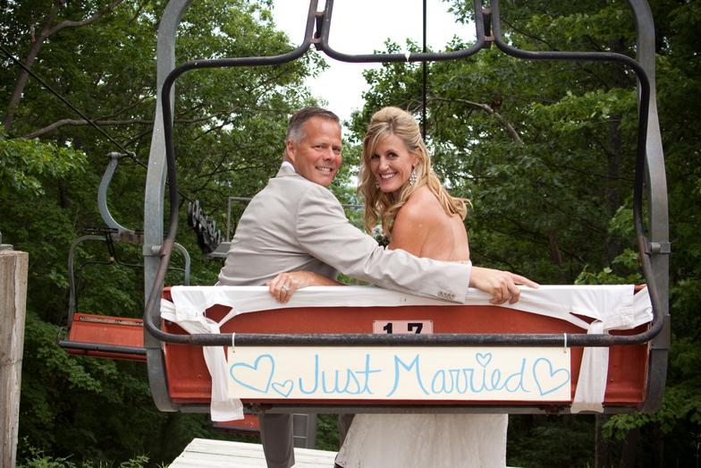 couple on just married ski lift