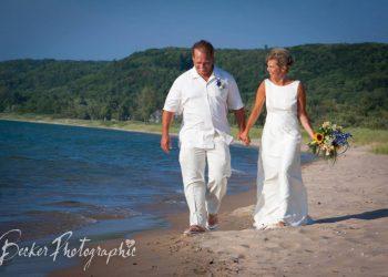 bride and groom walking along glen arbor
