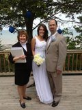 officiant and couple posing for picture