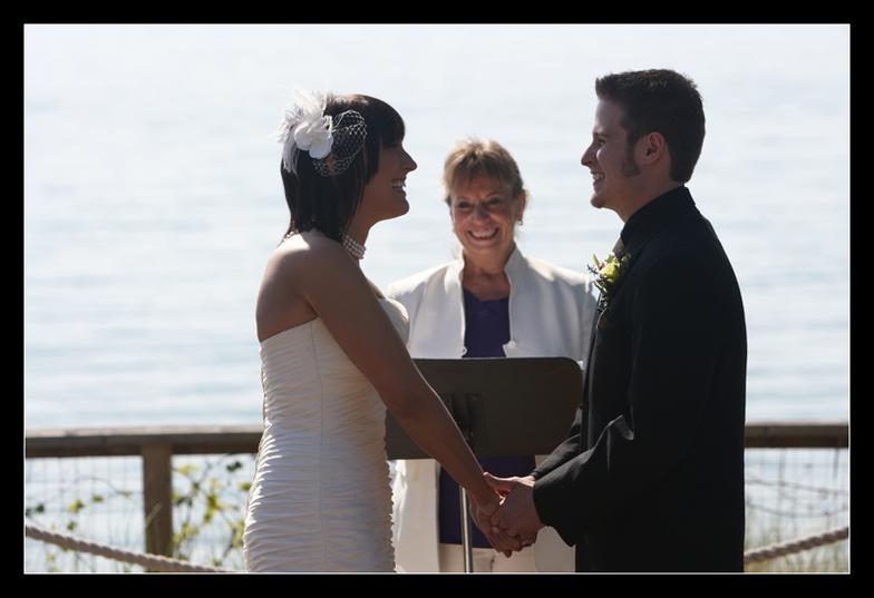 young couple getting married on pier