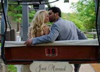 couple kissing over just married sign
