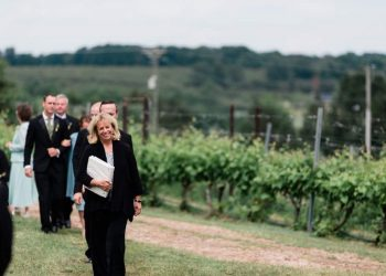 officiant leading party through vineyard
