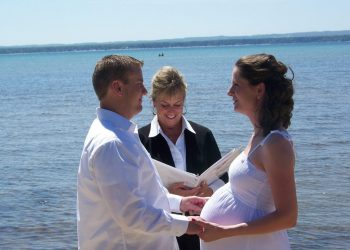pregnant bride and groom ceremony