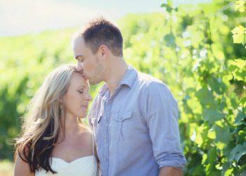 groom kissing wife on head