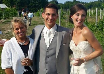 officiant and couple at vineyard wedding