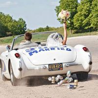 couple driving off in car just married